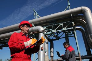 image of engineers inspecting Oil and Gas pipelines